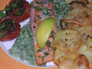 Salmon Fillet on creamed spinach served with roasted Maltese potatoes and tomatoes